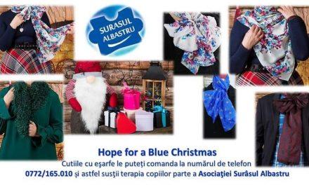 Donează ore de terapie micuților cu autism de la Surâsul Albastru, cumpărând eșarfa HOPE